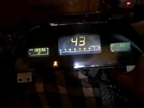 speedometer mazda Astina yang sudah mulai lepas polarize nya